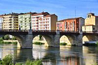 Miranda de Ebro view across Ebro river, new apartment buildings, Iglesia Espiritu Santo and Puente de Carlos III - Carlos III bridge, Burgos province,...