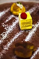 Italian Dolce desert dish comprising selection of mini cakes served with a chocolate and icing sugar powder, Ghetto Ebraico, Bologna, Emilia Romanga, ...