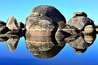Reflection in a lake of Los Barruecos, Caceres, Spain.