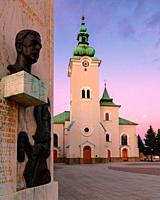 Memorial and a church in the main square of Ruzomberok. Slovakia.