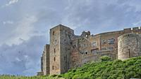 Bamburgh Castle is a castle on the northeast coast of England, by the village of Bamburgh in Northumberland. It is a Grade I listed building. . . The ...