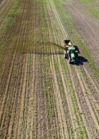 Three Oaks, Michigan - Dairy farmer Howard Payne spreads manure on a field as fertilizer.