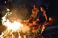 India, Kerala, Kannur region, Ganesh Kavu, Pottan Theyyam thrown on a pyre.