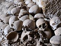 Skull and bones in ancient ossuary, Naples.