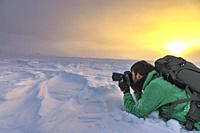 Photographer at Pallas-Yllastunturi National Park (Muonio, Lapland, Finland, Europe) (MR).
