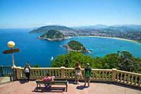 People at the viewpoint over the city. Monte Igueldo, San Sebastian, Spain.