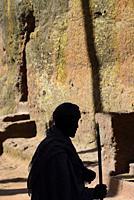 Ethiopia, Lalibela, World Heritage Site, Rock-hewn church of Bieta Maryam, Devotee in prayer.