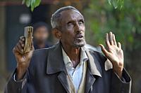 Ethiopia, Gonder, Bahata church, Morning mass, Christian devotee in prayer.