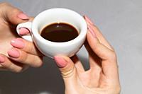 Taking the neapolitan coffee in ceramic cup.