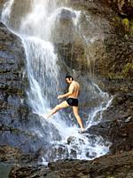 A man showering at the Mascarada waterfall, Cerler, Huesca, Aragon, Spain