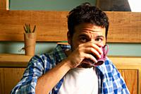 young man drinking coffee with casual clothes.