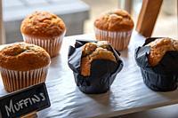 Warm breakfast muffins on display.