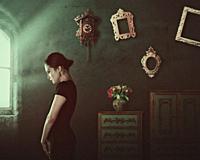 Alone. Female portrait with home interior.