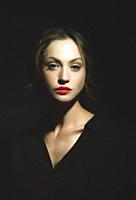 Hiden in the shadows. Dark beauty female portrait.