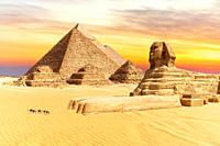 The Sphinx and the Pyramids of Giza, wonders of the world in Egypt, sunset view.