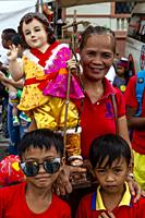 Local People Wait With Their Santo Nino Statues For The Arrival By Sea Of The Replica Santo Nino De Cebu, The Fluvial Procession, Dinagyang Festival, ...