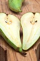 pear split in two on wood board for backgrounds and textures