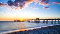 Sunset over the Gulf of Mexico pier in Venice Florida.