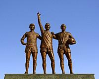 Manchester United Holy Trinity Statue Outside the Old Trafford Stadium, Manchester, England, United Kingdom.
