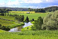 Rural landscape of a river valley and green fields on a beautiful day of summer. Halikko, Salo, Southwest of Finland.