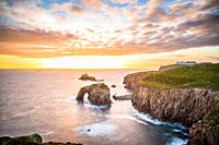 Dramatic sky at sunset with Enys Dodnan and the Armed Knight rock formations at Lands End, Cornwall, England, United Kingdom, Europe.