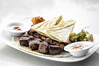 lebanese meshwi mixed bbq grilled meat set with chicken, lamb and beef in beirut restaurant.