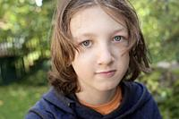Portrait of a Boy with Brown Hair Outdoors.