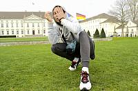young emotive youngster man in front of Bellevue Palace, in Berlin, Germany