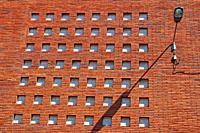 street lamp on brick facade, Vallvidrera district, Barcelona, Catalonia, Spain