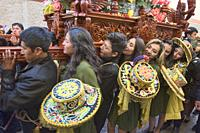 Participants carrying the holy shrine at the wild Virgen del Carmen Festival, held in Pisac and Paucartambo, Peru.