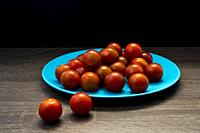 Smalle cherry tomatoes on plate