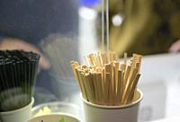 Coffee stir sticks in a cup.