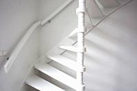 Stairs in modern white room, white wooden stairs with white wall modern.