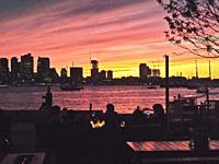 Sunset over Boston harbor and Boston, Massachusetts.