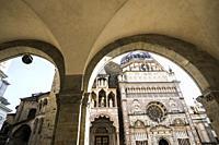 View of the Basilica of Santa Maria Maggiore and Colleoni Chapel (Cappella Colleoni) from the loggia arches of the Palazzo della Ragione, Piazza Vecch...