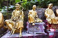 Statues of arhats (Buddhist equivalent of saints) on the way up to Ten Thousand Buddhas Monastery (Man Fat Sze). Sha Tin, New Territories, Hong Kong.