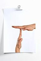 Blank sheet hanging on the wall with image of hands indicating break time.