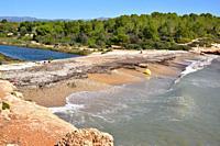 Coast line with lagoon, pebble beach and Mediterranean sea. This photo was taken in Cala Santes Creus, Ametlla de Mar, Tarragona province, Catalonia, ...