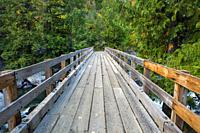A sturdy wooden bridge for hikers spans Icicle Creek along the Snow Lake trail in the Alpine Lakes Wilderness area in North Central Washington.