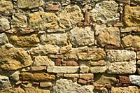 Architectural details of an external wall completely built in stone.