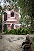 old portuguese colonial architecture building in macau city small park garden china.