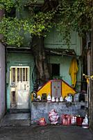 small chinese traditional local shrine in old taipa street of macau china.