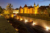 Evening at the Barbican and city walls in Warsaw, Poland.