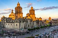 Metropolitan Cathedral and President's Palace in Zocalo Center of Mexico City Cars Traffic Mexico Afternoon.