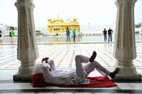 Amritsar, Punjab, India - Sikh devotee at the Golden Temple sanctuary, the holiest place of worship for Sikhs.
