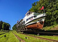 Tourist Boat in Cradle at Inclined Plane in Buczyniec, Elblag Canal, Warmian-Masurian Voivodeship, Poland.