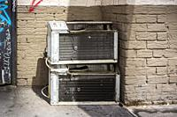 Defunct air conditioners outside an apartment building in New York on Monday, August 12, 2019.