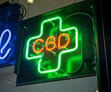 An illuminated sign in the window of a store in New York advertises the sale of CBD products, seen on Friday, August 16, 2019. CBD is the non-psychoac...