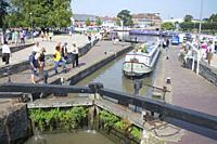 Narrow boat passing through a lock on the River Avon at Stratford-Upon-Avon UK.