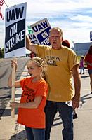 Flint, Michigan USA - 24 September 2019 - Layla Ferguson, 10, pickets the Flint Assembly Plant with her grandfather, Rick Artress, during the United A...